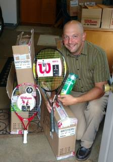Sandusky Recreation Director, Jason Werling, with new tennis racquets and balls given by Al's Clinics! Come to see the next organization we IMPACT!!