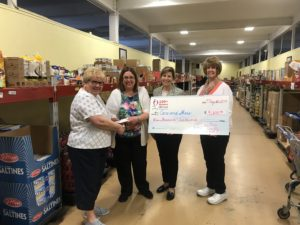Presenting Check to Care and Share - ( l to r) Linda Miller - Care and Share, Linda Ziegler -100 WWC, Norma Wible - presenter of this charity and Martha Miller - 100 WWC.