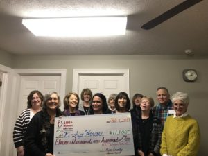 Kinship House Board members and representatives of 100+ Women deliver the donation.