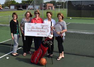 100+ Women Who Care in Erie Co presenting $10,200 to Lori Schlessman for Al's Clinic 5/17